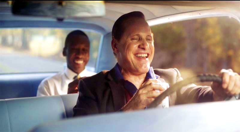 Tony Lip cracking a joke while driving and Don Shirley is enjoying it